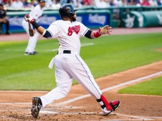 CLEVELAND, OH - AUGUST 11: Carlos Santana #41 of the Cleveland Indians hits an RBI single during the first inning against the New York Yankees at Progressive Field on August 11, 2015 in Cleveland, Ohio. (Photo by Jason Miller/Getty Images)  *** Local Caption *** Carlos Santana