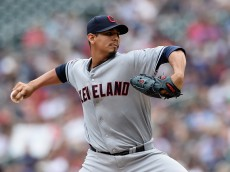 MINNEAPOLIS, MN - AUGUST 16: Carlos Carrasco #59 of the Cleveland Indians delivers a pitch against the Minnesota Twins during the first inning of the game on August 16, 2015 at Target Field in Minneapolis, Minnesota. (Photo by Hannah Foslien/Getty Images)