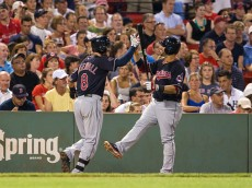 BOSTON, MA - AUGUST 17: Lonnie Chisenhall #8 of the Cleveland Indians celebrates his home run with teammate Mike Aviles #4 against the Boston Red Sox during the sixth inning at Fenway Park on August 17, 2015 in Boston, Massachusetts. (Photo by Rich Gagnon/Getty Images)