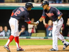 CLEVELAND, OH - AUGUST 25: Francisco Lindor #12 celebrates with Michael Brantley #23 of the Cleveland Indians after Brantley hit his second two run home run of the game during the eighth inning against the Milwaukee Brewers at Progressive Field on August 25, 2015 in Cleveland, Ohio. (Photo by Jason Miller/Getty Images)  *** Local Caption *** Francisco Lindor; Michael Brantley