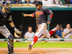 CLEVELAND, OH - AUGUST 26: Francisco Lindor #12 of the Cleveland Indians scores on a single by Lonnie Chisenhall #8 during the fourth inning against the Milwaukee Brewers at Progressive Field on August 26, 2015 in Cleveland, Ohio. (Photo by Jason Miller/Getty Images)