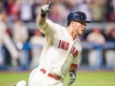 CLEVELAND, OH - AUGUST 29: Yan Gomes #10 of the Cleveland Indians celebrates as he rounds the bases after hitting a grand slam during the eighth inning against the Los Angeles Angels of Anaheim at Progressive Field on August 29, 2015 in Cleveland, Ohio. (Photo by Jason Miller/Getty Images)