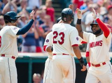 CLEVELAND, OH - AUGUST 30: Lonnie Chisenhall #8 and Michael Brantley #23 celebrate with Abraham Almonte #35 of the Cleveland Indians after Almonte hit a grand slam during the fifth inning against the Los Angeles Angels of Anaheim at Progressive Field on August 30, 2015 in Cleveland, Ohio. (Photo by Jason Miller/Getty Images)
