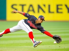 CLEVELAND, OH - AUGUST 12: Shortstop Francisco Lindor #12 of the Cleveland Indians can't get to a ground ball off the bat of Chase Headley of the New York Yankees during the third inning at Progressive Field on August 12, 2015 in Cleveland, Ohio. (Photo by Jason Miller/Getty Images)