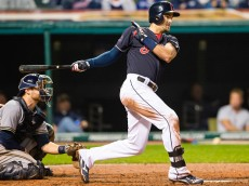 CLEVELAND, OH - AUGUST 26: Lonnie Chisenhall #8 of the Cleveland Indians hits an RBI single during the fourth inning against the Milwaukee Brewers at Progressive Field on August 26, 2015 in Cleveland, Ohio. (Photo by Jason Miller/Getty Images)