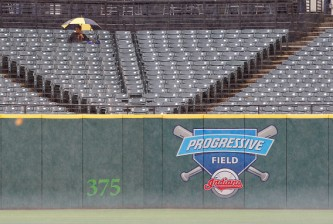 CLEVELAND, OH - SEPTEMBER 12:   A fan sits in the rain at Progressive Field in Cleveland, Ohio waiting for the rain delayed start of the  game between the Cleveland Indians and the Detroit Tigers on September 12, 2015 .   (Photo by David Maxwell/Getty Images)