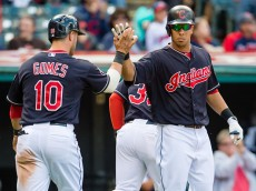 CLEVELAND, OH - SEPTEMBER 13: Yan Gomes #10 celebrates with Michael Brantley #23 of the Cleveland Indians after Gomes scored during the fifth inning against the Detroit Tigers during game one of a double header at Progressive Field on September 13, 2015 in Cleveland, Ohio. (Photo by Jason Miller/Getty Images)