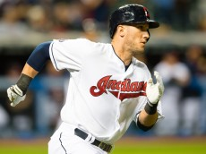 CLEVELAND, OH - SEPTEMBER 14: Yan Gomes #10 of the Cleveland Indians rounds first on an RBI double to right during the seventh inning against the Kansas City Royals at Progressive Field on September 14, 2015 in Cleveland, Ohio. (Photo by Jason Miller/Getty Images)  *** Local Caption *** Yan Gomes