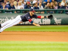 CLEVELAND, OH - SEPTEMBER 18: Third baseman Mike Aviles #4 of the Cleveland Indians dives for a ground ball hit by Jose Abreu #79 of the Chicago White Sox during the seventh inning at Progressive Field on September 18, 2015 in Cleveland, Ohio. (Photo by Jason Miller/Getty Images)  *** Local Caption *** Mike Aviles