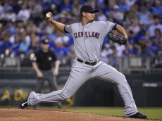 KANSAS CITY, MO - SEPTEMBER 25:  Carlos Carrasco #59 of the Cleveland Indians throws in the fist inning against the Kansas City Royals at Kauffman Stadium on September 25, 2015 in Kansas City, Missouri. (Photo by Ed Zurga/Getty Images)