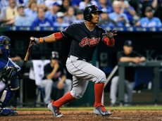 KANSAS CITY, MO - SEPTEMBER 26:  Jose Ramirez #11 of the Cleveland Indians hits a RBI double in the fourth inning against the Kansas City Royals at Kauffman Stadium on September 26, 2015 in Kansas City, Missouri. (Photo by Ed Zurga/Getty Images)
