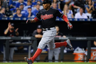 KANSAS CITY, MO - SEPTEMBER 26:  Jose Ramirez #11 of the Cleveland Indians runs home to score on a wild pitch by Kris Medlen #39 of the Kansas City Royals in the fourth inning at Kauffman Stadium on September 26, 2015 in Kansas City, Missouri. (Photo by Ed Zurga/Getty Images)
