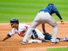 CLEVELAND, OH - SEPTEMBER 30: Francisco Lindor #12 of the Cleveland Indians is safe at second as shortstop Eduardo Nunez #9 of the Minnesota Twins tries to make the tag during the fifth inning at Progressive Field on September 30, 2015 in Cleveland, Ohio during game one of a doubleheader. (Photo by Jason Miller/Getty Images)  *** Local Caption *** Francisco Lindor; Eduardo Nunez