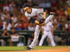 BOSTON, MA - AUGUST 18:  Ryan Webb #54 of the Cleveland Indians follows through on a pitch against the Boston Red Sox in the fourth inning at Fenway Park on August 18, 2015 in Boston, Massachusetts.  (Photo by Jim Rogash/Getty Images)