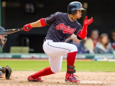 CLEVELAND, OH - SEPTEMBER 13: Francisco Lindor #12 of the Cleveland Indians hits a two RBI single during the fifth inning against the Detroit Tigers during game one of a double header at Progressive Field on September 13, 2015 in Cleveland, Ohio. (Photo by Jason Miller/Getty Images)