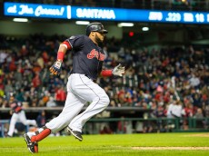 CLEVELAND, OH - OCTOBER 2: Carlos Santana #41 of the Cleveland Indians rounds first his way to second on an RBI double to center during the third inning against the Boston Red Sox at Progressive Field on October 2, 2015 in Cleveland, Ohio. (Photo by Jason Miller/Getty Images)  *** Local Caption *** Carlos Santana