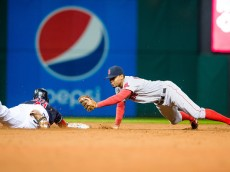 CLEVELAND, OH - OCTOBER 3: Carlos Santana #41 of the Cleveland Indians is safe at second on a hit to center as shortstop Xander Bogaerts #2 of the Boston Red Sox tries to make the tag during the eighth inning at Progressive Field on October 3, 2015 in Cleveland, Ohio. (Photo by Jason Miller/Getty Images)