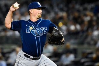NEW YORK, NY - SEPTEMBER 10: Kirby Yates #49 of the Tampa Bay Rays throws a pitch during a game against the New York Yankees at Yankee Stadium on September 10, 2014 in the Bronx borough of New York City.  (Photo by Alex Goodlett/Getty Images)