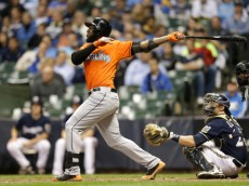 MILWAUKEE, WI - SEPTEMBER 11: Marcell Ozuna #13 of the Miami Marlins hits a two-run homer in the top of the eighth inning against the Milwaukee Brewers at Miller Park on September 11, 2014 in Milwaukee, Wisconsin. (Photo by Mike McGinnis/Getty Images)