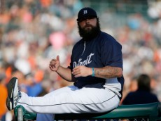 DETROIT, MI - JULY 19:  Pitcher Joba Chamberlain #44 of the Detroit Tigers sits on top of a railing around the dugout before game two of a doubleheader against the Cleveland Indians at Comerica Park on July 19, 2014 in Detroit, Michigan. The Indians defeated the Tigers 5-2. (Photo by Duane Burleson/Getty Images)