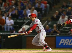 ARLINGTON, TX - APRIL 13:  Collin Cowgill #7 of the Los Angeles Angels hits a two run homerun against the Texas Rangers in the 5th inning at Globe Life Park in Arlington on April 13, 2015 in Arlington, Texas.  (Photo by Ronald Martinez/Getty Images)