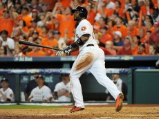 HOUSTON, TX - OCTOBER 11:  Chris Carter #23 of the Houston Astros hits a solo home run in the seventh inning against the Kansas City Royals in game three of the American League Division Series at Minute Maid Park on October 11, 2015 in Houston, Texas.  (Photo by Eric Christian Smith/Getty Images)