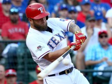 ARLINGTON, TX - OCTOBER 12:  Mike Napoli #25 of the Texas Rangers grounds into a seventh inning double play against the Toronto Blue Jays in game four of the American League Division Series at Globe Life Park in Arlington on October 12, 2015 in Arlington, Texas.  (Photo by Ronald Martinez/Getty Images)