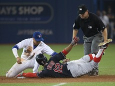 TORONTO, CANADA - SEPTEMBER 1: Francisco Lindor #12 of the Cleveland Indians slides safely into second base with a double in the eighth inning during MLB game action as he evades the tag by Ryan Goins #17 of the Toronto Blue Jays on September 1, 2015 at Rogers Centre in Toronto, Ontario, Canada. (Photo by Tom Szczerbowski/Getty Images)