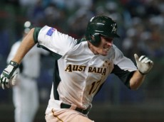 TAICHUNG, TAIWAN - MARCH 04:  Mitch Dening of Australia run into first base in the sixth inning during the World Baseball Classic First Round Group B match between South Korea and Australia at Intercontinental Baseball Stadium on March 4, 2013 in Taichung, Taiwan.  (Photo by Chung Sung-Jun/Getty Images)