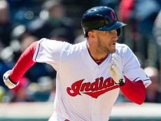 CLEVELAND, OH -  APRIL 5: Yan Gomes #10 of the Cleveland Indians runs out an RBI single during the fourth inning of the opening day game against the Boston Red Sox at Progressive Field on April 5, 2016 in Cleveland, Ohio. (Photo by Jason Miller/Getty Images)