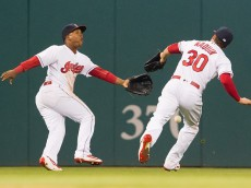 CLEVELAND, OH -  APRIL 6: Left fielder Jose Ramirez #11 and center fielder Tyler Naquin #30 of the Cleveland Indians drop a fly ball hit by Chris Young #30 of the Boston Red Sox during the sixth inning at Progressive Field on April 6, 2016 in Cleveland, Ohio. (Photo by Jason Miller/Getty Images)  *** Local Caption *** Jose Ramirez; Tyler Naquin
