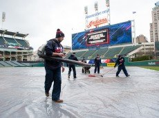 CLEVELAND, OH -  APRIL 7: The Cleveland Indians grounds crew preps the field for inclement weather after the game between the Boston Red Sox and the Cleveland Indians was postponed at Progressive Field on April 7, 2016 in Cleveland, Ohio. (Photo by Jason Miller/Getty Images)  *** Local Caption ***