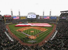 CHICAGO, IL - APRIL 08: Members of the Chicago White Sox and the Cleveland Indians stand during the National Anthem before the home opener at U.S. Cellular Field on April 8, 2016 in Chicago, Illinois. (Photo by Jonathan Daniel/Getty Images)