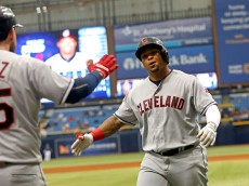 ST. PETERSBURG, FL - APRIL 14:  Marlon Byrd #6 of the Cleveland Indians celebrates with Roberto Perez #55 after hitting a two-run home run off of pitcher Chris Archer #22 of the Tampa Bay Rays during the sixth inning of a game on April 14, 2016 at Tropicana Field in St. Petersburg, Florida.  (Photo by Brian Blanco/Getty Images)