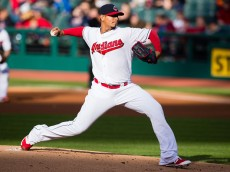 CLEVELAND, OH -  APRIL 19: Starting pitcher Carlos Carrasco #59 of the Cleveland Indians pitches during the first inning against the Seattle Mariners at Progressive Field on April 19, 2016 in Cleveland, Ohio. (Photo by Jason Miller/Getty Images)