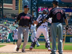 DETROIT, MI - APRIL 23: Yan Gomes #10 of the Cleveland Indians slaps hands with teammate Lonnie Chisenhall #8 of the Cleveland Indians after scoring a run in the first inning during a MLB game against the Detroit Tigers at Comerica Park on April 23, 2016 in Detroit, Michigan. (Photo by Dave Reginek/Getty Images)