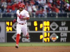PHILADELPHIA, PA - APRIL 30: Freddy Galvis #13 of the Philadelphia Phillies rounds the bases after hitting a two-run home run in the first inning during a game against the Cleveland Indians at Citizens Bank Park on April 30, 2016 in Philadelphia, Pennsylvania. (Photo by Hunter Martin/Getty Images)