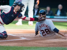 CLEVELAND, OH - MAY 3: Catcher Yan Gomes #10 of the Cleveland Indians tags out J.D. Martinez #28 of the Detroit Tigers at home during the first inning at Progressive Field on May 3, 2016 in Cleveland, Ohio. (Photo by Jason Miller/Getty Images)