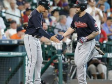 HOUSTON, TX - MAY 11:  Mike Napoli #26 of the Cleveland Indians receives congratulations from third base coach Mike Sarbaugh #16 after hitting a home run in the fourth inning against the Houston Astros at Minute Maid Park on May 11, 2016 in Houston, Texas.  (Photo by Bob Levey/Getty Images)