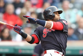 CLEVELAND, OH - MAY 17: Carlos Santana #41 of the Cleveland Indians singles to center field during the third inning of the interleague game against the Cincinnati Reds on May 17, 2016 at Progressive Field in Cleveland, Ohio. (Photo by Leon Halip/Getty Images)