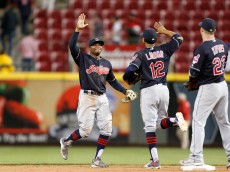 CINCINNATI, OH - MAY 18:  Rajai Davis #20 of the Cleveland Indians is congratulated by Francisco Lindor #12 after defeating the Cincinnati Reds 8-7 in twelve innings at Great American Ball Park on May 18, 2016 in Cincinnati, Ohio. (Photo by Kirk Irwin/Getty Images)