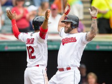 CLEVELAND, OH -  MAY 29: Francisco Lindor #12 celebrates with Mike Napoli #26 of the Cleveland Indians after both scored on a home run by Napoli during the fourth inning against the Baltimore Orioles at Progressive Field on May 29, 2016 in Cleveland, Ohio. (Photo by Jason Miller/Getty Images)