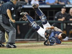 Omaha, NE - JUNE 22:  of the Virginia Cavaliers of the Vanderbilt Commodores in the first inning during game one of the College World Series Championship Series on June 22, 2015 at TD Ameritrade Park in Omaha, Nebraska.  (Photo by Peter Aiken/Getty Images) *** Local Caption ***