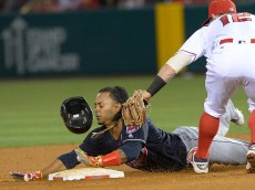 ANAHEIM, CA - JUNE 10: Michael Martinez #1 of the Cleveland Indians is tagged out by Johnny Giavotella #12 of the Los Angeles Angels on an attempted steal in the fifth inning of the game at Angel Stadium of Anaheim on June 10, 2016 in Anaheim, California. (photo by Jayne Kamin-Oncea/Getty Images)
