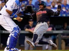 KANSAS CITY, MO - JUNE 14:  Francisco Lindor #12 of the Cleveland Indians slides into home plate to score during the 5th inning of the game against the Kansas City Royals at Kauffman Stadium on June 14, 2016 in Kansas City, Missouri.  (Photo by Jamie Squire/Getty Images)