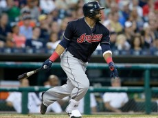 DETROIT, MI - JUNE 24:  Carlos Santana #41 of the Cleveland Indians singles against the Detroit Tigers during the sixth inning at Comerica Park on June 24, 2016 in Detroit, Michigan. (Photo by Duane Burleson/Getty Images)