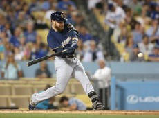 LOS ANGELES, CALIFORNIA - JUNE 17:  Jonathan Lucroy #20 of the Milwaukee Brewers hits an RBI double in the sixth inning against the Los Angeles Dodgers at Dodger Stadium on June 17, 2016 in Los Angeles, California.  (Photo by Stephen Dunn/Getty Images)