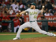ANAHEIM, CA - JUNE 23:  Sean Doolittle #62 of the Oakland Athletics pitches during the ninth inning of a baseball game against the Los Angeles Angels of Anaheim at Angel Stadium of Anaheim on June 23, 2016 in Anaheim, California.  (Photo by Sean M. Haffey/Getty Images)
