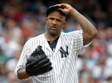 NEW YORK, NY - JULY 16: CC Sabathia #52 of the New York Yankees reacts against the Boston Red Sox during the fourth inning at Yankee Stadium on July 16, 2016 in the Bronx borough of New York City. (Photo by Adam Hunger/Getty Images)