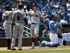 KANSAS CITY, MO - JULY 20:  Tyler Naquin #30 of the Cleveland Indians is congratulated by teammates after hitting a home run during the 5th inning of the game against the Kansas City Royals at Kauffman Stadium on July 20, 2016 in Kansas City, Missouri.  (Photo by Jamie Squire/Getty Images)